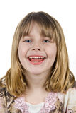 Little girl smiling. A girl smiles while looking at the camera with a white background Stock Photos