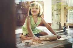 Little Girl Smiling Bake Cookie Concept royalty free stock photography