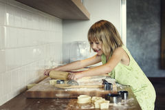 Little Girl Smiling Bake Cookie Concept royalty free stock image