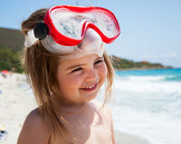 Little girl smiling on beach Stock Photo