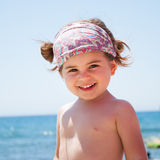 Little girl smiling on beach Royalty Free Stock Photography