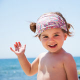 Little girl smiling on beach Royalty Free Stock Photo