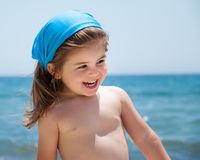 Little girl smiling on beach Stock Image