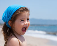 Little girl smiling on beach Royalty Free Stock Image