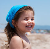 Little girl smiling on beach Stock Photography
