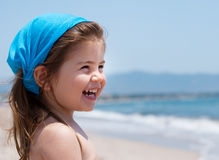 Little girl smiling on beach Royalty Free Stock Photos