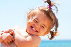 Little girl smiling on beach Stock Images