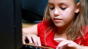 Little girl smiling at camera during computer class. In elementary school stock video footage