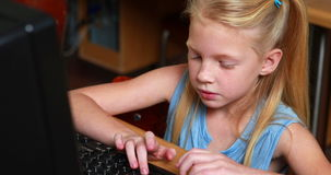 Little girl smiling at camera during computer class. In elementary school stock footage