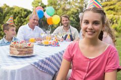 Little girl smiling at camera at her birthday party Stock Photos