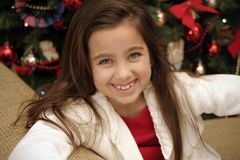 Little girl smiling at Christmas. 8 year old child smiling at Christmas Royalty Free Stock Image