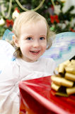 Little girl smiling with christmas gift Royalty Free Stock Images