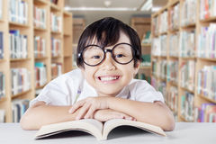 Little girl smiling friendly in the library Stock Image