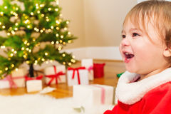 Little girl smiling in front of the Christmas tree Stock Image