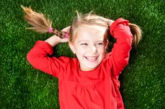 Little girl smiling on grass Royalty Free Stock Photo