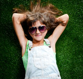 Little girl smiling on grass Stock Photos
