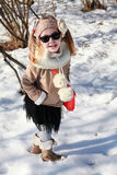 Little girl smiling with hands in pockets in snow Royalty Free Stock Photo