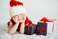 Little Girl smiling in Hat Santa. Little Girl smiling in red Hat Santa Royalty Free Stock Image