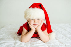 Little Girl smiling in Hat Santa. Little Girl smiling in red Hat Santa Stock Photography