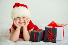 Little Girl smiling in Hat Santa Royalty Free Stock Photos