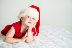 Little Girl smiling in Hat Santa Stock Image