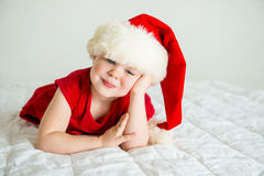 Little Girl smiling in Hat Santa. Little Girl smiling in red Hat Santa Royalty Free Stock Images
