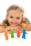 Little girl smiling with her clay people family Stock Photos