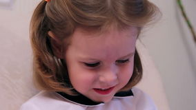 Little girl smiling stock footage