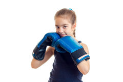 Little girl smiling and holding hands in a large adult boxing gloves near individuals Royalty Free Stock Images