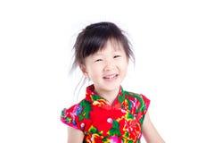 Little girl smiling over white background Stock Photo