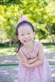 Little girl smiling in park Royalty Free Stock Image