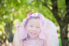 Little girl smiling in park Royalty Free Stock Photography