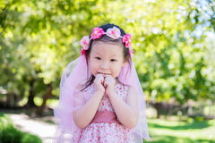 Little girl smiling in park Royalty Free Stock Images