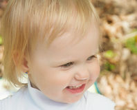 Little girl smiling in a park a sunny day. Little girl smiling in the Park on a sunny day. joyous emotions of a child Stock Photo