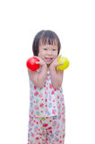 Little girl smiling with plastic balls Royalty Free Stock Images