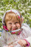 Little girl smiling in soft background. The little girl in the blurred background Stock Photo