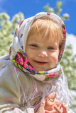 Little girl smiling in soft background. The little girl in the blurred background Royalty Free Stock Photography