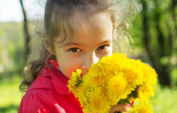 Сгеу little girl smiling at spring sunny day Stock Photography