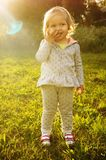 Little girl smiling. Little girl standing in the grass smiling Royalty Free Stock Photography