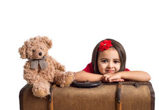 Little Girl smiling with suitcase and toy bear Royalty Free Stock Image