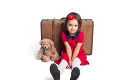 Little Girl smiling with suitcase and toy bear. Beautiful little Girl smiling with suitcase and toy bear Royalty Free Stock Photos