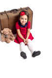 Little Girl smiling with suitcase and toy bear Royalty Free Stock Photography
