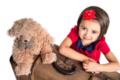 Little Girl smiling with suitcase and toy bear Stock Photography