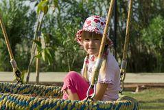 Little Girl Smiling on Swing Royalty Free Stock Photo