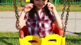 Little girl smiling on a swing stock footage