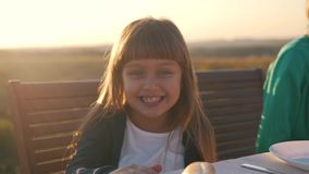 Little girl smiling at the table stock footage