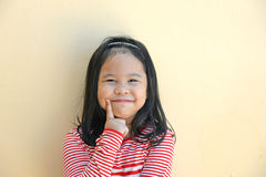 Little girl smiling and thinking Stock Photos