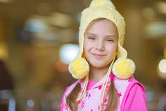 Little girl smiling in yellow hat Stock Photography