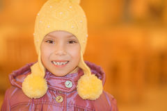 Little girl smiling in yellow hat Royalty Free Stock Photo
