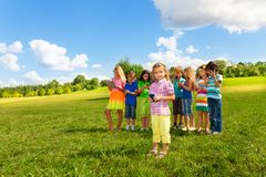 Little girl sms with friends Stock Image
